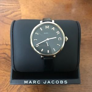 Black leather and gold detail watch.